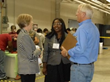 HPG Chamber CEO Becky McDonough (l) talks with Hopewell Vice Mayor Jasmine Gore and ITAC CEO Sidney Harrison