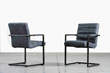 Chair with armrests upholstered in leather