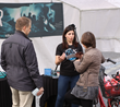 A volunteer from the Church of Scientology of Denmark provides information at a drug education booth on Strøget, the famous Copenhagen walking street.