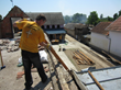 A Scientology Volunteer Minister assists with the salvage of useable building materials from a condemned home in the village of Kopanica, in Bosnia and Herzegovina.
