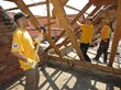 Scientology Volunteer Ministers retrieve beams from a condemned home in the village of Kopanica, in Bosnia and Herzegovina.