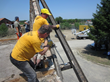 Scientology Volunteer Ministers extract beams from a condemned home in the village of Kopanica, in Bosnia and Herzegovina.