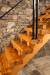 This staircase crafted by NEWwoodworks is made of reclaimed Character Select Heart Pine.