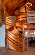 A custom crafted curved staircase by NEWwoodworks.