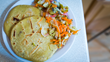 Pupusas are gluten free corn masa tortillas stuffed with beans, cheese, and/or various meats served with a crunchy and savory side salad curtido.
