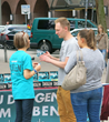 A volunteer from the Church of Scientology of Hamburg shows The Truth About Drugs booklet to a visitor to a drug education information booth.