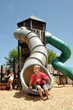 At the center of the playground is a massive tower with tube slides!