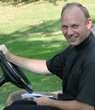 Father Thomas will leave the drums at home and be happy to drive the golf cart!