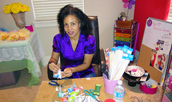 Photo of Dawn McCleary at her work desk.