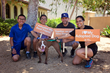 The Tovar family of Los Angeles pose with Madeline, whom they adopted in June from the Best Friends Pet Adoption & Spay/Neuter Center in Mission Hills.