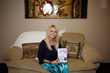 Hogrefe holds a copy of Own Your Journey to Optimal Hormone Balance. (Photo Provided)