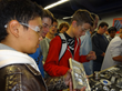 Rocklin High School students look at products made with RobbJack cutting tools during a Manufacturing Day tour.