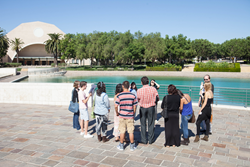 High school students take a walking tour of Soka University.