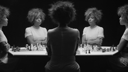 Still from the video Chess, 2013, by Lorna Simpson