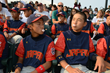 At the opening ceremonies of the Cal Ripken World Series, the defending championship team from Japan helps Big League Chew Bubble Gum achieve a GUINNESS WORLD RECORDS® official title.