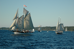 "Tall Ships in the evening ""Grand Parade of  Sail"" on West Grand Traverse Bay"