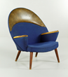 "Hans Wegner ""Peacock"" chair, with blue wool upholstery and leather arm and headrests"