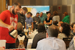 Crimson Cup's Independents Day conference featured demonstrations of hand-pour techniques using Chemex coffee brewers