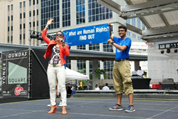 On the stage at Dundas Square July 15, 2014, at the 8th annual YD|TO—Youth Day Toronto, Youth for Human Rights volunteers invited the crowd to learn their rights.