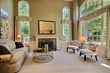 Inviting Living Room with Vaulted Ceilings and floor to ceiling windows