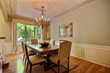 Formal Dining Room with Artisan Paintings and Wrought Iron Chandelier