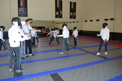 Beginner Youth Fencers During Their Fencing Lesson at Academy of Fencing Masters