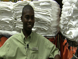 Photo of Lajarvis Smiley working in the laundry service department at the Hilton St. Petersburg Bayfront.