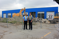 Joe Pannella and Michael Dann await the opening of the newly expanded Mississauga trailer service centre.
