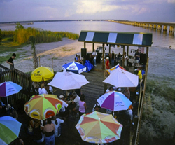 The view from the back of Dan B's busy restaurant overlooking the deck and Bay St. Louis before Hurricane Katrina.