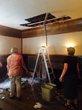 SAH Executive Director Pauline Saliga and Development Director Carolyn Garrett in the living room where a portion of the ceiling collapsed