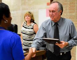 Superintendent Martin congratulates honorees