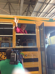 Lieutenant Governor Kay Ivey waves from one of Mobile County Public Schools new Blue Bird Propane Vision buses.
