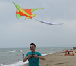 "Flying high above Catania Beach in Sicily, a kite proclaims ""Make Health your High, Not Drugs""—part of the year-round commitment of Scientologists to promote drug-free living."