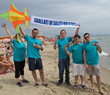 "With their banner ""Get high on life, not drugs,"" volunteers from the Church of Scientology distributed copies of The Truth About Drugs booklet on Sicily's Catania Beach."