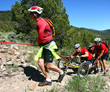 Climbing a trail by mountain bike and hand cycle.