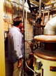 John Eifler takes a look at pipes in the basement of the house