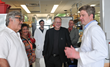 Dr. Chris Adams (right) talks with music legend and Eagle member, Tony Orlando (left) and comedian Tom Parks (center) during a tour of the new $25M FOE Diabetes Research Center, UI, Aug. 23, 2014.