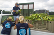 Omega Protein employees load some of the nearly 6,000 pounds of produce gleaned from local corn crops on Saturday.
