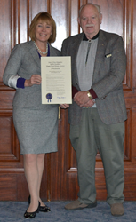 FIJA New Hampshire state contact Dick Marple receives a 2013 Jury Appreciation Day proclamation from Governor Maggie Wood Hassan.