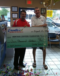 Rocky of Casullo's Automotive & Customer celebrating $10,000 charity donation.