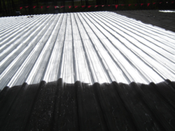 New Revitalizer™ liquid waterproofing membranes restore and protect asphalt-based and metal roof systems photo