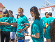 Volunteers pick up copies of The Truth About Drugs materials in preparation for a booklet distribution event at Clearwater Beach, Florida.
