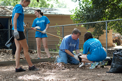 Centenary President David Rowe and students work during World House Service Day