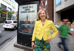 "Franke James in front of her ""Do Not Talk about Climate Change"", Ottawa May 2013"