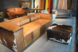 Hair-on hide leather sofa, leather ottoman, leather hides.