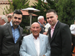 Phil Hil Scholarship Recipients Haman Ezzati and Ali Moosavi with Sir Stirling Moss at the Pebble Beach Concours d'Elegance.