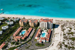 Aerial view of The Venetian on Grace Bay and sister resort, The Tuscany Resort.