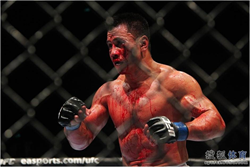 Cung Le on Aug 23rd trying desperately to see his opponent while bleeding from his both eyes
