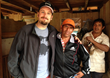 Brandon Bir (left) of Crimson Cup Coffee & Tea meets with coffee farmers in Peru