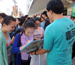 Volunteer from the Church of Scientology of Kaohsiung collects signatures on a drug-free pledge—part of this summer's activities to help youth decide to live drug-free.